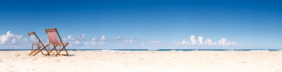 beach and chairs - panoramic - 940x240.jpg
